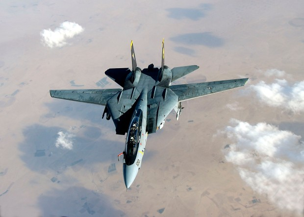 An F-14D Tomcat deploys its fuel probe prior to aerial refueling during a mission over the Persian Gulf Region. (US Navy/released)