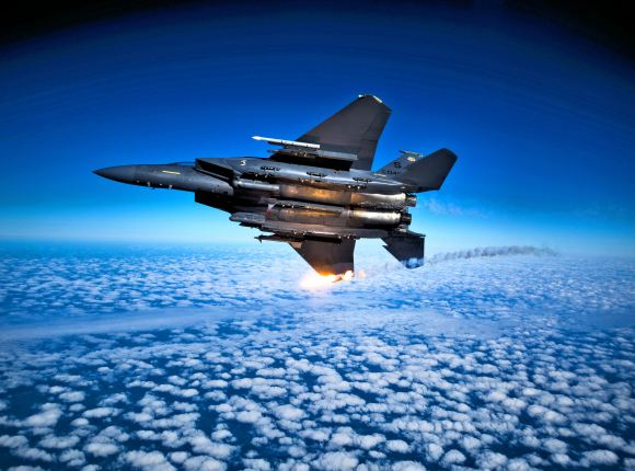 A USAF F-15E Strike Eagle aircraft from 335 FS releases flares during a training mission. Photograph by Staff Sgt. Michael B. Keller.