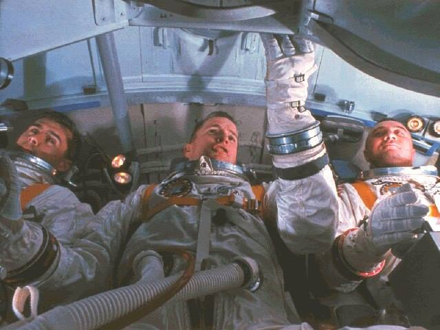 Astronauts for the first Apollo Mission (L-R) Roger B. Chaffee, Edward H. White and Virgil I. Grissom practice for the mission in the Apollo Mission Simulator. National Aeronautics and Space Administration - NASA Photo.