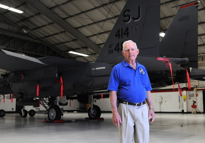 "Retired Lt. Col. Robert Pardo in front of a 333rd Fighter Squadron F-15E Strike Eagle during a tour of Seymour Johnson Air Force Base, North Carolina, Oct. 10, 2014. Pardo is known for his ""Pardo's Push"" maneuver as a 433rd Tactical Fighter Squadron F-4 Phantom pilot stationed at Ubon Royal Thai AFB, Thailand, when he saved another F-4 aircrew from having to eject in North Vietnam by pushing their plane in the air over the Laotian border and into relative safety. (U.S. Air Force photo/Airman 1st Class Ashley J. Thum)"
