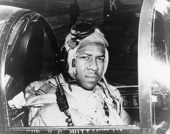 "Historical file photo of Ensign Jesse L. Brown, seated in the cockpit of an F4U-4 Corsair Fighter plane, the U.S. Navy's first black naval aviator. Ensign Brown flew with the ""Swordsmen"" of Fighter Squadron Three Two (VF-32) aboard the aircraft carrier USS Leyte (CV 32) during the Korean Conflict. While in Korea, he was killed in action and posthumously awarded the Distinguished Flying Cross."