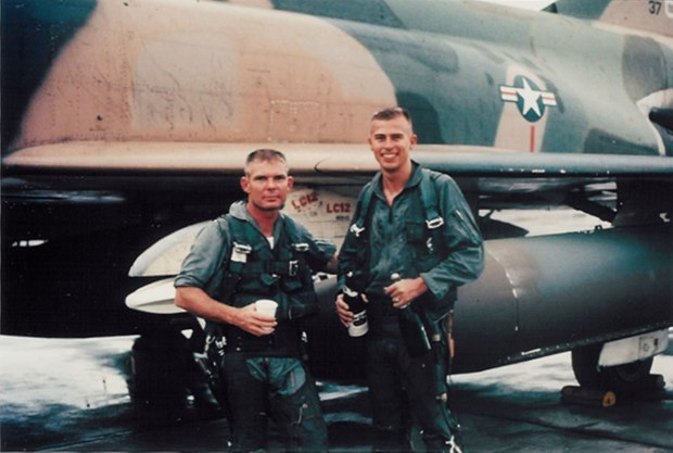 "Capt. John Robert ""Bob"" Pardo and 1st Lt. Steve Wayne after Wayne's 100th mission (USAF photograph)"