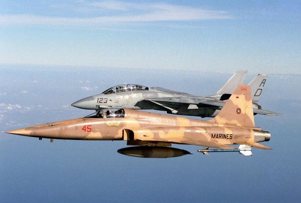 """Whoa, MiG-28s, no one's been this close before!"" Just kidding, that's an F-5 with an F-14. US Navy photograph."