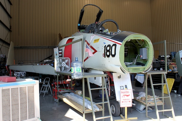 145310 sit in the maintenance hangar minus the nose cone. The cone has been removed to allow the aircraft to fit inside with the door closed.