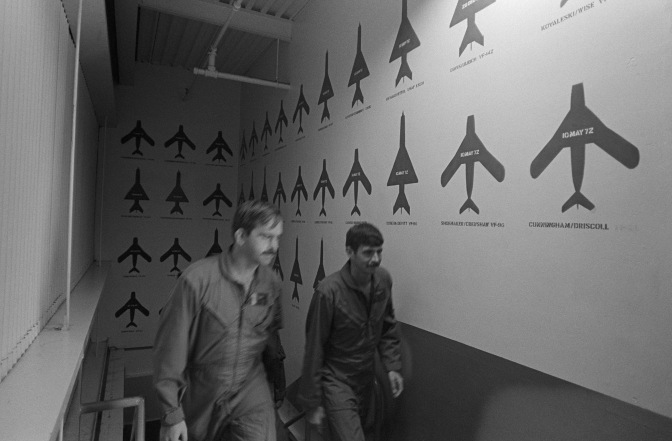 Red MiG silhouettes are painted on the walls at the Navy Fighter Weapons School to mark each victory by a Navy or Marine Corps air crew during the war in Southeast Asia. US Navy photograph.