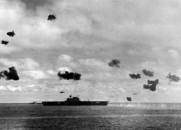 Two Type 97 shipboard attack aircraft from the Japanese aircraft carrier Hiryu fly past the U.S. Navy carrier USS Yorktown (CV-5), after dropping their torpedoes during the mid-afternoon attack, 4 June 1942. (Official U.S. Navy photograph, take from the USS Pensacola (CA-24))