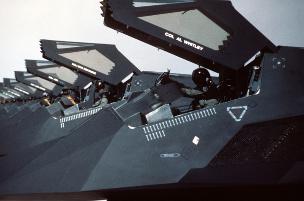 U.S. Air Force F-117 Nighthawks from the 37th Tactical Fighter Wing are lined up on the flight line at Nellis Air Force Base, Nevada, with canopies raised following their return from Saudi Arabia where they took part in Operation Desert Storm. (U.S. Air Force Photograph/Released)