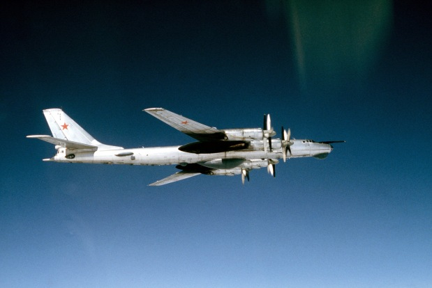 An air-to-air right side view of a Soviet Tu-95RTs Bear D strategic bomber aircraft. Date Shot: 5 May 1983 (U.S. Navy photograph/released)