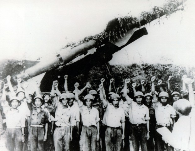 North Vietnamese SAM crew in front of SA-2 launcher.