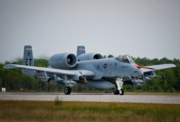 An A-10C Thunderbolt II from the 40th Flight Test Squadron, moves down the runway at Eglin Air Force Base, Fla. The aircraft is loaded up with weaponry to test the combat carriage limits of the Sargent Fletcher external fuel tank. The A-10 flight personnel are testing to ensure the A-10 can carry the tank into a combat environment safely. If proven to be safe to carry, the tank will add up to 60 minutes of flight time to its combat sortie. (U.S. Air Force photo/Samuel King Jr.)