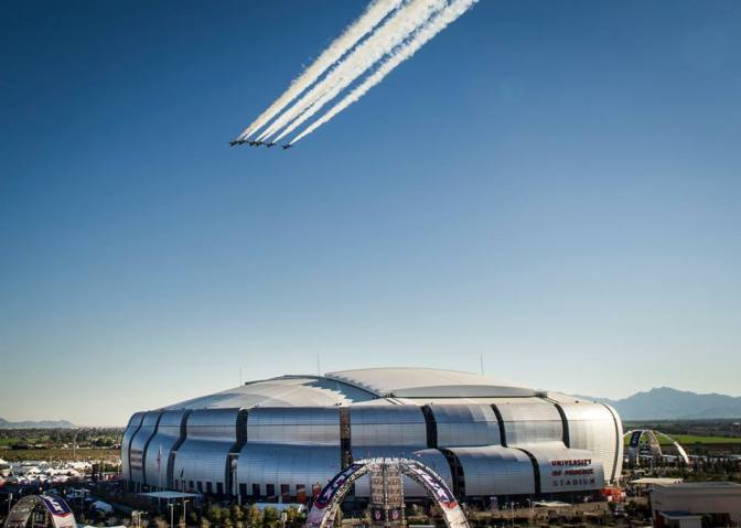 The Thunderbirds delta formation flies over the University of Phoenix stadium during Super Bowl XLIX. Although 63,000 people will see the flyover from the stadium, millions are estimated to view the game on live television. The Thunderbirds fly as close as 3 feet apart during their signature delta formation. The Thunderbirds launched out of Nellis Air Force Base, Nev. (U.S. Air Force Photo by Senior Airman Jason Couillard)