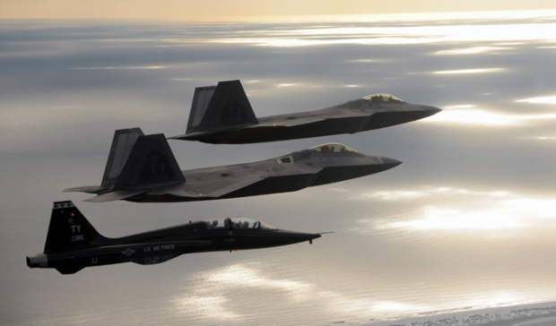 Two F-22 Raptors and a T-38 Talon from Tyndall Air Force Base, Florida, fly together during a 43rd Fighter Squadron Basic Course training mission Oct. 7, 2013 over Florida.  (U.S. Air Force photo/Master Sgt. J. Wilcox)