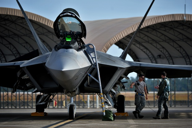 An F-22 Raptor from the 94th Fighter Squadron, Joint Base Langley-Eustis, Va., is ready for take-off for an integrated training mission on Eglin Air Force Base, Fla., Nov. 6, 2014. The F-35s and F-22s flew offensive counter air, defensive counter air and interdiction missions, maximizing effects by employing fifth-generation capabilities together. (U.S. Air Force photo/Master Sgt. Shane A. Cuomo)