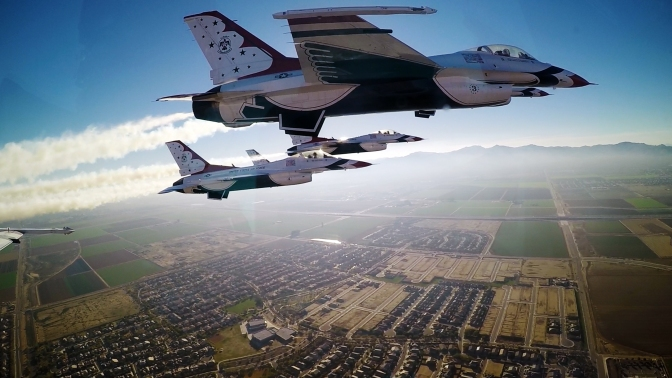 Thunderbirds pilots approach the University of Phoenix Stadium to perform a flyover during the Super Bowl XLIX game, Phoenix, Feb. 1, 2015. (U.S. Air Force photo/Tech. Sgt. Manuel J. Martinez)