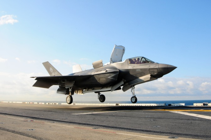 Lt. Col. Fred Schenk lifts an F-35B Lightning II off the flight deck of the amphibious assault ship USS Wasp. The F-35B is the Marine Corps Joint Strike Force variant of the Joint Strike Fighter. The aircraft is undergoing testing aboard Wasp. (U.S. Navy/Released)
