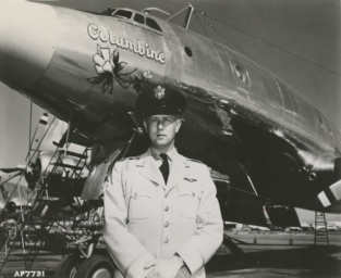 LtCol. William G. Draper stands with Columbine II in 1954. (U.S. Air Force file photo)