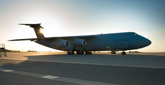 C-5 M Super Galaxy tail number 5010 awaits on the ramp as the sun rises at Travis Air Force Base, Calif. (Released - U.S. Air Force Photograph/Heide Couch)