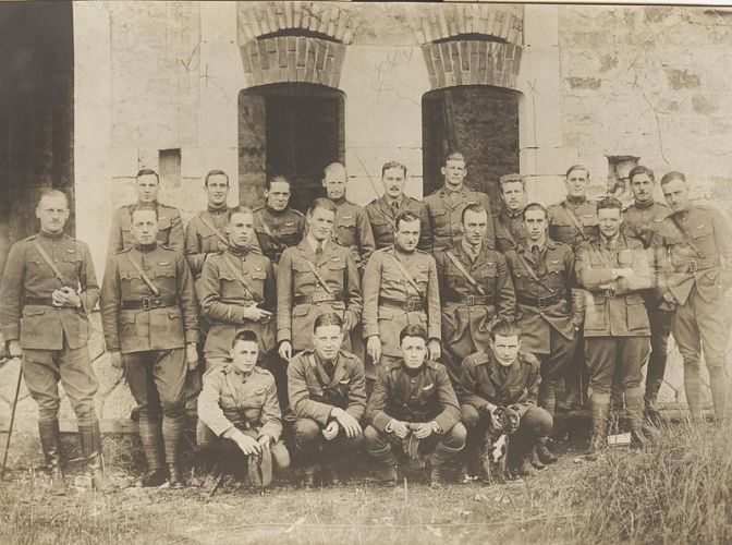 """Pilots of the 94th Aero (Pursuit) Squadron in France, June 1918. Captain Edward V. """"Eddie"""" Rickenbacker stands in the center row, fourth from the right. (U.S. Army archival photograph)"""