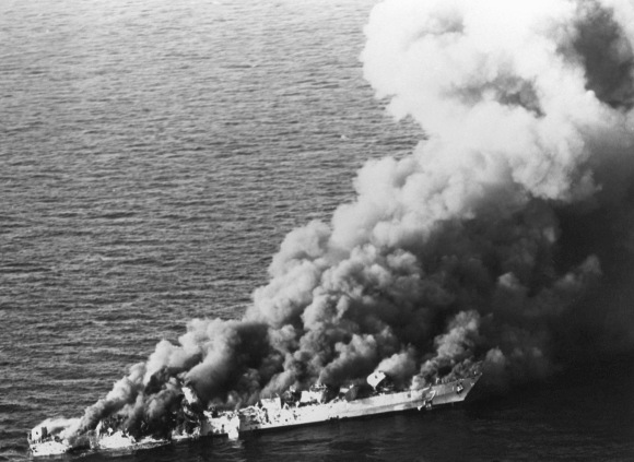 The Iranian frigate IS Sahand (74) burns after being attacked by aircraft of Carrier Air Wing II from the nuclear-powered aircraft carrier USS Enterprise (CVN-65), in retaliation for the mining of the guided missile frigate USS Samuel B. Roberts (FFG-58). The ship was hit by three Harpoon missiles plus cluster bombs. (U.S. Navy/Released)