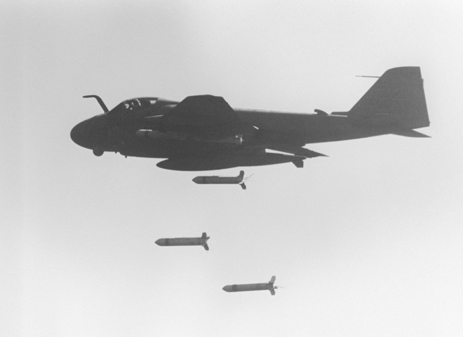 An A-6E Intruder aircraft drops CBU-59 cluster bombs over Iranian targets. (U.S. Navy/released)