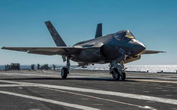 The F-35C Lightning II carrier variant Joint Strike Fighter conducts its first arrested landing aboard the USS Nimitz (CVN 68) aircraft carrier off the coast of San Diego, November 3, 2014. The arrested landing is part of initial at-sea developmental testing expected to last two weeks. (U.S. Navy video by Mass Communication Specialist 1st Class Brett Cote / RELEASED)