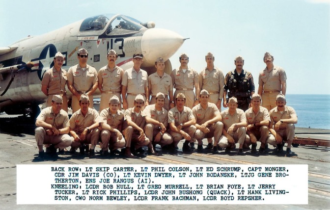 VF-211 pilots from their 1972 cruise. Jerry Tucker is fourth from the left, kneeling down. Frank Bachman is second from the right, also kneeling down. (U.S. Navy archival photograph/released)