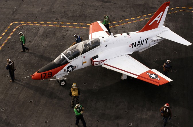 Flight deck personnel prepare a T-45A Goshawk for taxi across the flight deck aboard the Nimitz-class aircraft carrier USS Ronald Reagan (CVN 76). U.S. Navy photo by Mass Communication Specialist 2nd Class Aaron Burden (RELEASED)