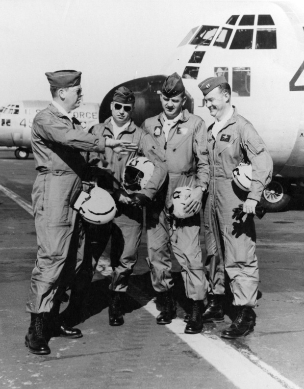 The original Four Horsemen, Gene Chaney, James Akin, David Moore and Bill Hatfield have a conversation amongst themselves in front of a C-130. The Four Horsemen are a C-130 demonstration team that came together in 1957. (Courtesy photo)