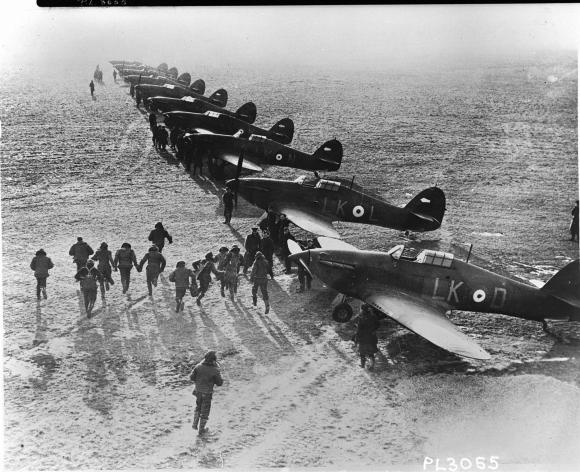 Royal Canadian Air Force pilots race to their Hawker Hurricanes to do battle with the Nazis in the sky. (RCAF)