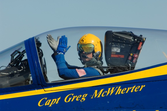 Capt. Greg McWherter, commanding officer and flight leader of the U.S. Navy flight demonstration squadron, the Blue Angels, responds to the crowd at the Guardians of Freedom Air Show. The Blue Angels performed in Lincoln as part of the 2011 show season and in celebration of the Centennial of Naval Aviation. (U.S. Navy photo by Petty Officer 2nd Class Jen Blake)