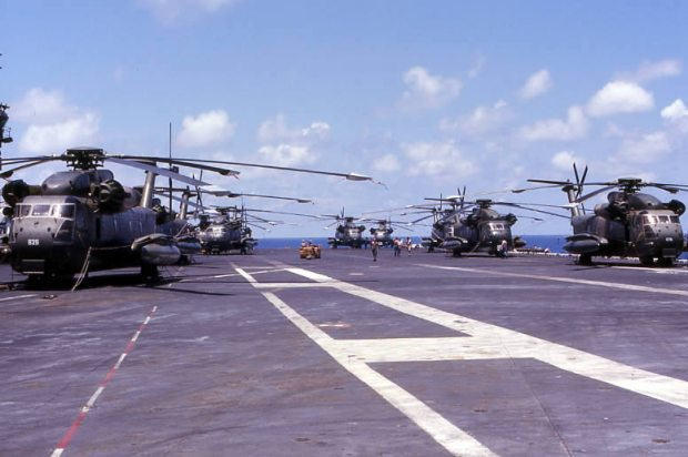 U.S. Air Force Sikorsky HH-53C Super Jolly Green Giant helicopters on the deck of the aircraft carrier USS Midway (CV-41) during en:Operation Frequent Wind, April 1975. (U.S. Navy/released)
