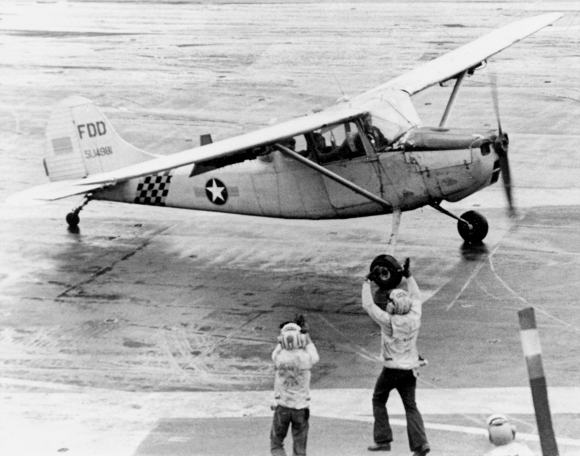 Major Buang Lee comes to a halt aboard the USS Midway in a Cessna O-1 Bird Dog. (US Navy/released)