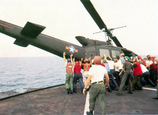 South Vietnamese UH-1H being pushed overboard to make room for a Cessna O-1 landing. Operation Frequent Wind, the final operation in Saigon, began April 29, 1975. During a nearly constant barrage of explosions, the Marines loaded American and Vietnamese civilians, who feared for their lives, onto helicopters that brought them to waiting aircraft carriers. The Navy vessels brought them to the Philippines and eventually to Camp Pendleton, Calif. (U.S. Navy/released)