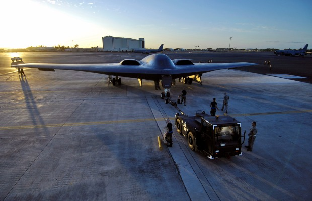 A B-2 Spirit is towed to a parking spot at Hickam Air Force Base, Hawaii. The LRS-B will likely serve as a supplement to the US Air Force's B-2 and B-1B fleet while gradually replacing the mainstay B-52, which has been in service since the late 1950s. (U.S. Air Force photo/Tech. Sgt. Shane A. Cuomo)