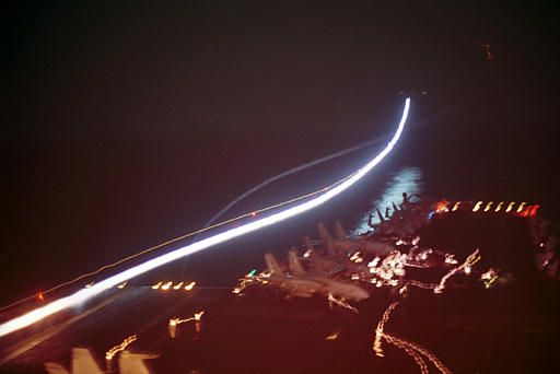 A nighttime long-exposure shot of fighter jets launching from the USS Enterprise on October 7th, 2001, on strike missions against Al Qaeda and Taliban strongholds. (Navy photo by Todd A. Bent via AP)