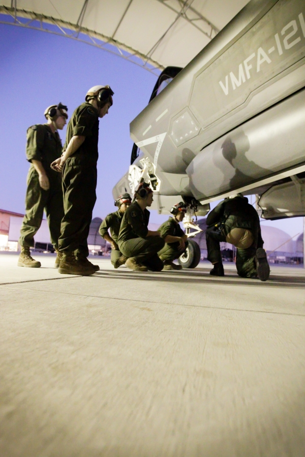 U.S. Marines with Marine Fighter Attack Squadron 121 (VMFA-121) inspect an F-35B Lightning II aircraft in support of Weapons and Tactics Instructor Course (WTI) 1-16 at Marine Corps Air Station Yuma, Ariz., Oct. 1, 2015. Newbold's flight was historic in nature since it marked the first WTI class to fully integrate F-35s into the course. WTI 1-16 is a seven week training event hosted by Marine Aviation Weapons and Tactics Squadron One (MAWTS-1) cadre which emphasizes operation integration of the six functions of Marine Corps aviation in support of a Marine Air Ground Task Force. MAWTS-1 provides standardized advanced tactical training and certification of unit instructor qualifications to support Marine Aviation Training and Readiness and assists in developing and employing aviation weapons and tactics. (U.S. Marine Corps photo by Chief Warrant Officer 3 Jorge A. Dimmer MAWTS-1 COMCAM/Released)