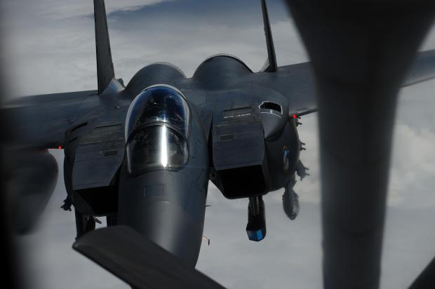 "An F-15E Strike Eagle, from the 336th Fighter Squadron also known as the ""Rocketeers,"" Seymour Johnson AFB, N.C., Seymour Johnson Air Force Base, maneuvers into position to receive fuel from a KC-135 Stratotanker, assigned to the 340th Expeditionary Air Refueling Squadron, over Afghanistan in support of Operation Enduring Freedom, March 29."