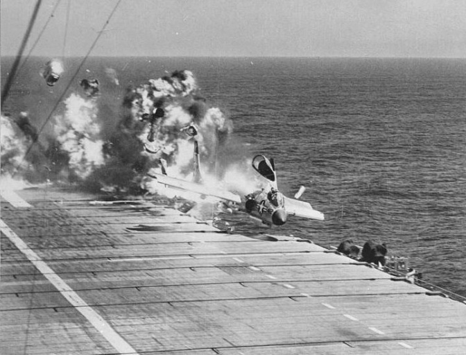 F7U-3 Cutlass, BuNo 129595, 'D 412', of VF-124, suffers ramp strike on landing aboard USS Hancock during carrier qualifications off of the California coast. The pilot, LCDR Jay Alkire, USNR, executive officer of VF-124, along with a number of deck crew. (US Navy/released)