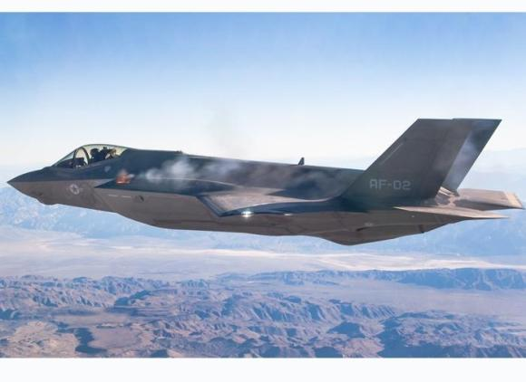 Flight test model AF-2 fires its internal GAU-22/A 4-barrel cannon for the first time in-flight. Photograph:  Chad Bellay, Edwards F-35 Integrated Test Force, released.
