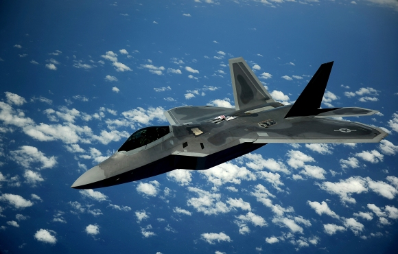 A 1st Fighter Wing's F-22 Raptor from Joint Base Langley-Eustis, Va., pulls away from a KC-135 Stratotanker with the 756th Air Refueling Squadron, Joint Base Andrews Naval Air Facility, Md., after refueling off the east coast, May 10, 2012. The first Raptor assigned to the Wing arrived, Jan. 7, 2005. This aircraft was allocated as a trainer, and was docked in a hanger for maintenance personnel to familiarize themselves with its complex systems. The second Raptor, designated for flying operations, arrived, Jan. 18, 2005. On Dec. 15, 2005, Air Combat Command commander, along with the 1st FW commander, announced the 27th Fighter Squadron as fully operational capable to fly, fight and win with the F-22.