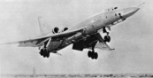 A right front underside view of a Soviet Tu-22 Blinder bomber aircraft in flight.  (Substandard image)