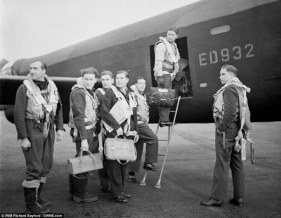 Wing Commander Guy Gibson and his crew board their Avro Lancaster A3-G (ED 932/G) aircraft for the Dambusters raid in 1943. Pictured from left to right: Flight Lieutenant R D Trevor-Roper DEM; Sergeant J Pulford; Flight Sergeant G A Deering RCAF; Pilot Officer F M Spafford DFM RAAF; Flight Lieutenant R E G Hutchinson DFC; Wing Commander Guy Gibson and Pilot Officer H T Taerum RCAF (MoD/released)