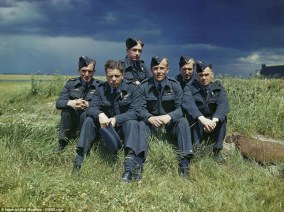 A 617 Squadron Lancaster Bomber crew are pictured sat next to the airfield at RAF Scampton in Lincolnshire during the Second World War (MoD/released)