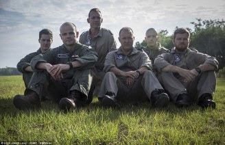 Aircrewmen of 617 Squadron strike the same iconic pose of their Second World War predecessors on the grass beside the airfield at MCAS Beaufort, South Carolina, USA. From left: Rich Pavey, Wing Cdr Jon Butcher, CPO Gary Lister, Chief Tech Gary Gibbons, Cpl Patrick Bearefield, AET Alfred Burrows (MoD/USMC/released)