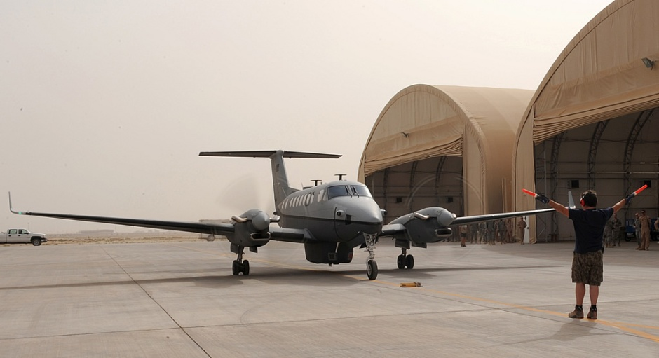 A US Army MC-12 Liberty based off the Beechcraft King Air 350, arriving at Balad Air Base in Iraq, circa 2009. SEASPRAY used King Airs as well, flying out of MacDill AFB and other bases of operations on sorties into Central and South America, though all of their aircraft were ostensibly civilian, at least in appearance. (US Army photograph/released)