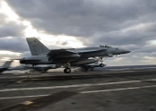 An F/A-18E Super Hornet, assigned to the Flying Eagles of Strike Fighter Squadron (VFA) 122, performs an arrested landing on the flight deck of the aircraft carrier USS George Washington (CVN 73) during flight operations.  (U.S. Navy photo by Petty Officer 3rd Class Wyatt L. Anthony)