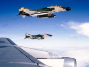 """Two U.S. Air Force McDonnell F-4D-30-MC Phantom II fighters (s/n 66-7576, 66-7628) from the 435th Tactical Fighter Squadron, 8th Tactical Fighter Wing, over Vietnam, off the wing of a Boeing KC-135A Stratotanker. F-4D 66-7576 was written off in Vietnam on 30 July 1972."" (USAF photograph/released)"