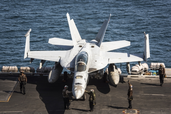"Sailors assigned to the ""Bounty Hunters"" of Strike Fighter Squadron (VFA) 2 perform pre-flight checks on an F/A-18F Super Hornet aboard the Nimitz-class aircraft carrier USS Carl Vinson (CVN 70)"